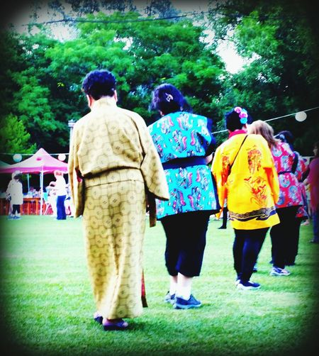 Women Dancing Together Rear View Full Length Real People Outdoors Grass Men Lifestyles Japanese Style Okinawa Matsuri Adult Japanese Culture MatsuriFestival Grass Kimonos Large Group Of People Buenos Aires Matsuri Friendship FunGreen Color Day Tree Women Togetherness Nature