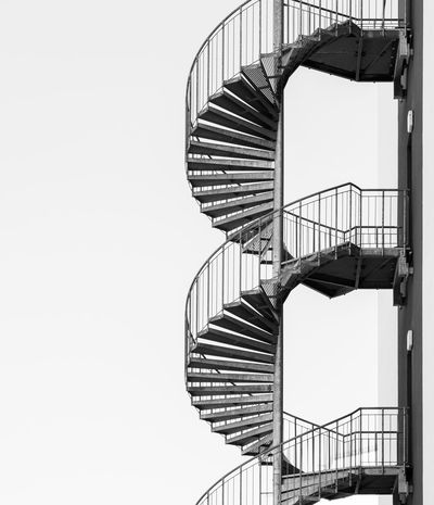 Black And White Black And White Best Of Stairways Staircase Architecture Steps And Staircases Built Structure Railing Spiral Spiral Staircase No People Low Angle View Sky Clear Sky Building Exterior Copy Space Shadow Repetition Metal Pattern