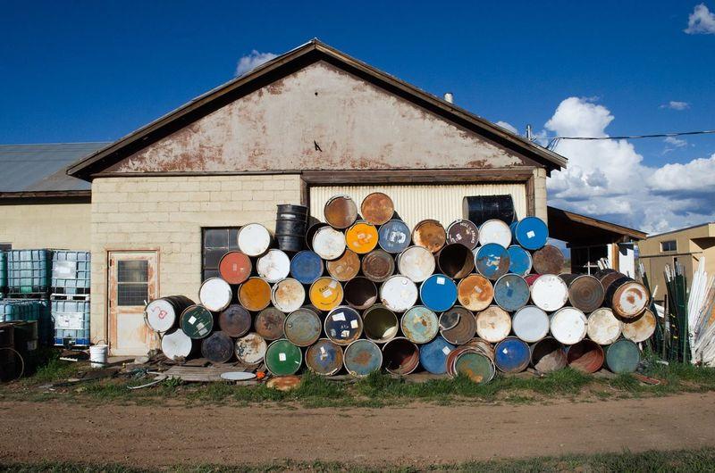 Stack Of Barrels Against Built Structure