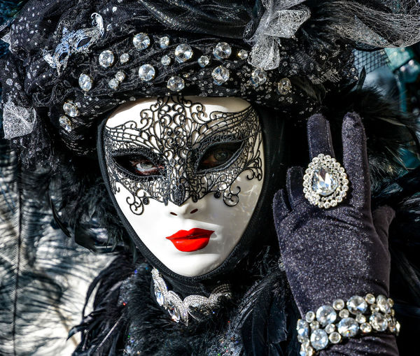 Close-up portrait of woman wearing venetian mask
