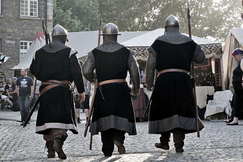 Rear view of men in medieval costume at hordel
