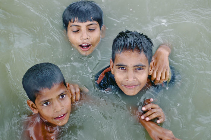Best EyeEm Shot Chlidhood Adult Bonding Boys Child Childhood Close-up Day Elementary Age Girls Happiness Headshot High Angle View Leisure Activity Looking At Camera Outdoors People Playing Portrait Real People Smiling Swimming Swimming Pool Togetherness Water Wet Love Is Love The Portraitist - 2018 EyeEm Awards