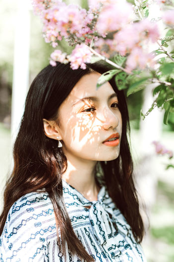 Adult Beautiful Woman Beauty Close-up Contemplation Day Flower Flowering Plant Focus On Foreground Front View Hair Hairstyle Headshot Human Face Long Hair One Person Outdoors Plant Portrait Women Young Adult Young Women