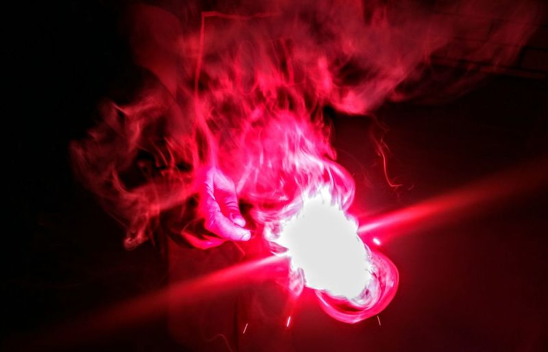 Red Smoke - Physical Structure Arts Culture And Entertainment Indoors  One Person People Close-up Sparkler Firework Display Sparks Flares🎆🎆 Low Angle View Diwali 2017 Firework No People Illuminated Red Queen Fusion Red Beauty Pink Color Mobile Photography Indian Festival Awe Red Hot Smoky