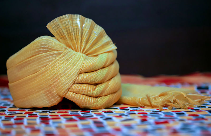 Close-up of wedding turban on table