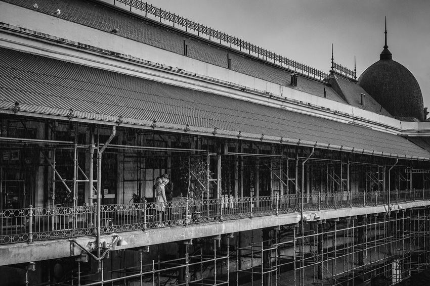 Kiss under construction Architectural Feature Architecture Building Exterior Built Structure City Life Couple Couple - Relationship Couples❤❤❤ Day Love Love ♥ Market Marketplace Mercado Do Bolhão Monochrome Photography Old Outdoors Rain Rainy Days Sky Tall - High Travel Destinations