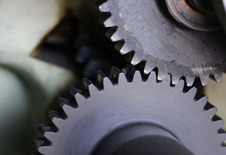 Gear Machinery Machine Part Industry Metal Equipment Teamwork Unity Connection Serrated Manufacturing Equipment Wheel Engine Steel Metal Industry Industrial Equipment Partnership - Teamwork Cooperation Close-up Coordination Background Texture