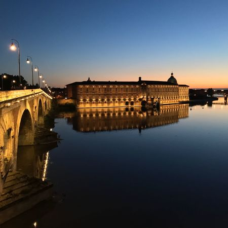 Architecture Built Structure Building Exterior Reflection Water Clear Sky Sky Travel Destinations Outdoors Waterfront No People Illuminated Bridge - Man Made Structure Sunset Nature Day City