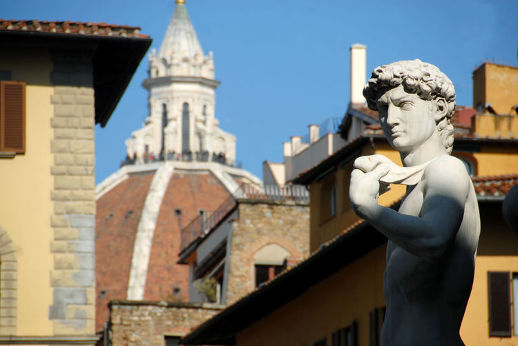 Statue of historic building against sky