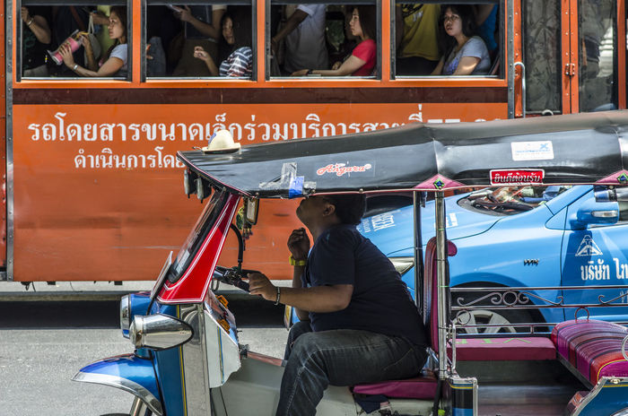 Time to enjoy with pluck on TukTuk Bangkok Spotted In Thailand Bus Day Hand Joyously Leisure Activity Lifestyles Parked People Person Pluck Plucking Relax Relaxation Road Side View Sitting Street Photography Taxi Traffic Jam Transportation TukTuk Tuktuk Driver Young Women