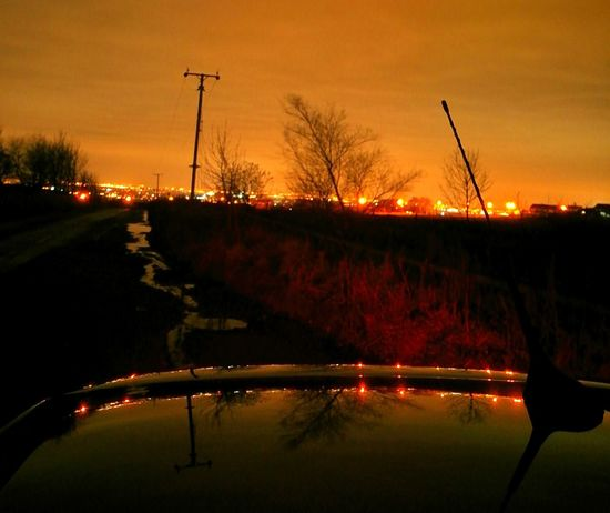 Early Morning Light Pollution Water Reflection Car Tree Sunset Dusk No People Transportation Silhouette City Outdoors Illuminated Beauty In Nature Nature