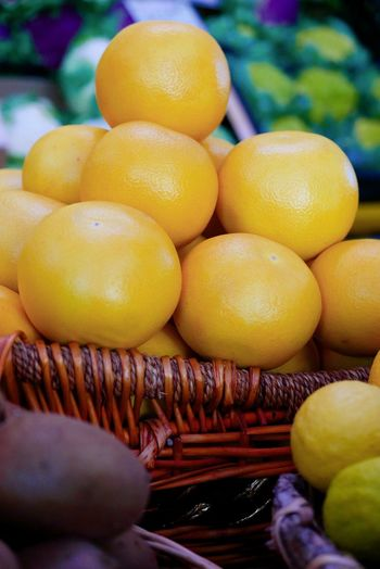 Close-up of fruits in basket for sale