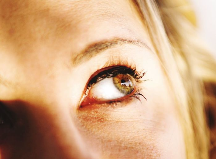 Cropped image of thoughtful woman with hazel eye