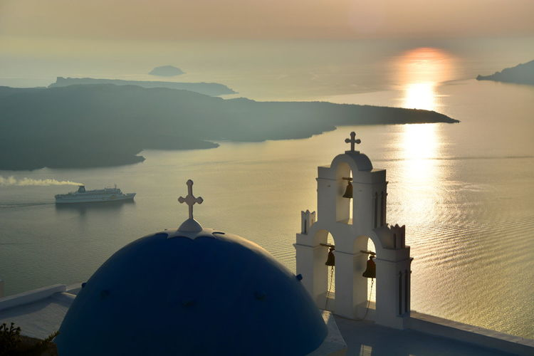 Agios Theodori. Firostefani, Santorini Aegean Sea Agios Theodori Belltower Caldera Catholic Church Cyclades Dome Europe Firostefani Greece Greek Imerovigli Santorini Santorini Island Santorini, Greece Sea Summer Sunset Sunset_collection Tourism Greece Travel Travel Photography The Great Outdoors With Adobe