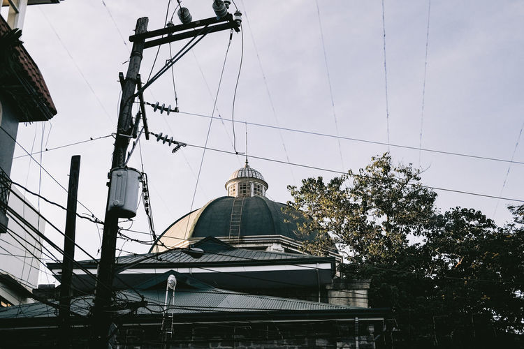 Low angle view of church and building against sky