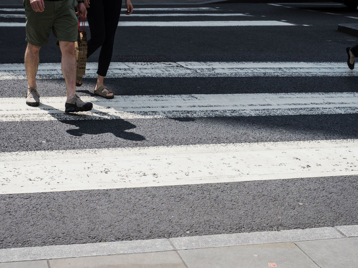 Low Section Of People Crossing Road In City