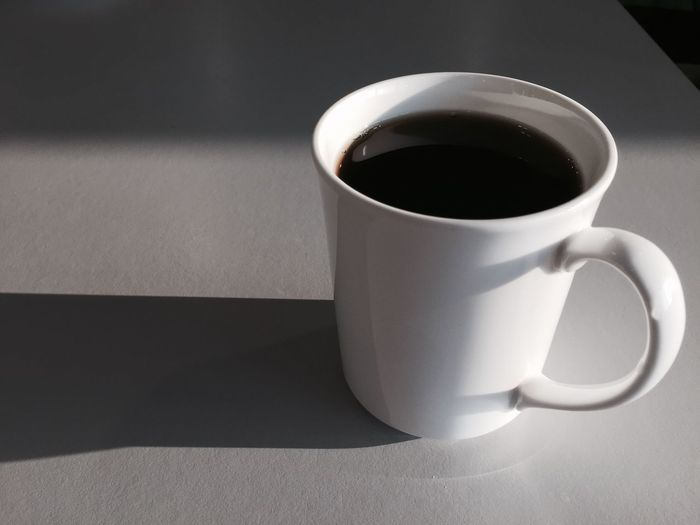 Close-Up Of Black Coffee On Table