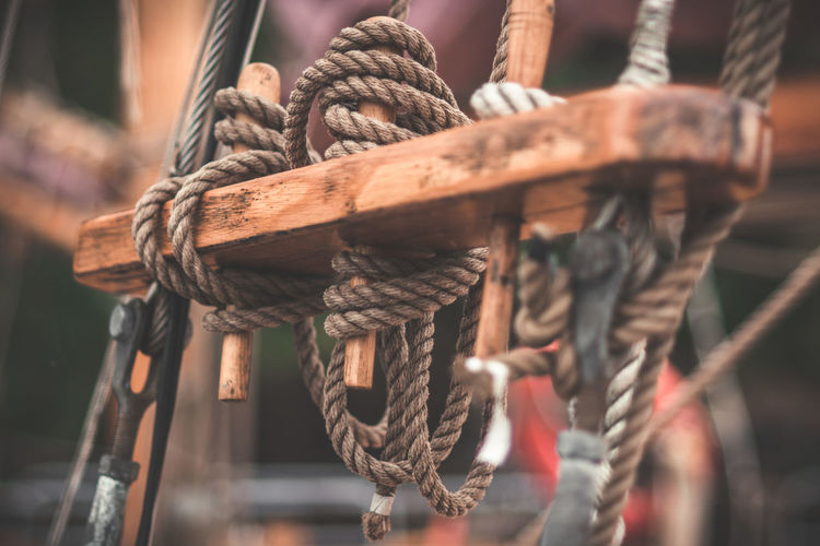 Close-up of ropes tied on boat