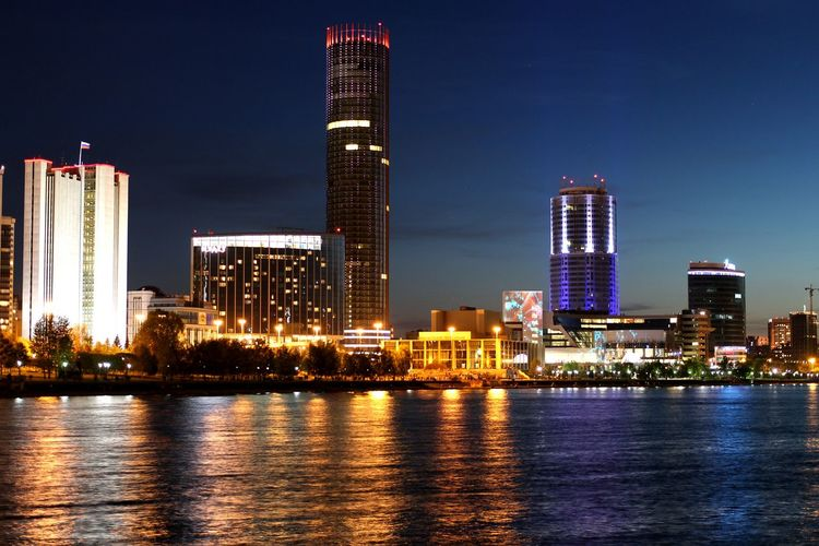 Architecture Urban Skyline City Night Illuminated Cityscape Modern Downtown District Building Exterior City Life Sky Water Outdoors No People Built Structure Skyscraper Office Building Exterior Water Reflections