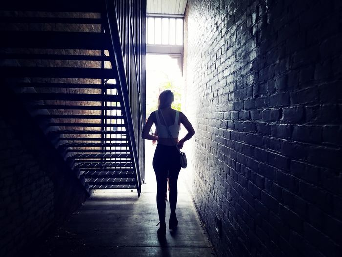 Silhouette Woman Girl Walking Alley Staircase Light And Shadow darkness and light Full Length Protection Athlete Rainy Season Wet Street Scene Narrow Steps And Staircases