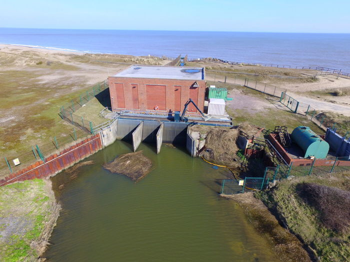 This pumping station in Kessingland will be lost to the sea in 5-10 years through coastal erosion Aerial Shot Aerial Photography Aerial View Architecture Built Structure Coastal Defences Coastal Erosion Day Drone Photography Kessingland No People Pumping Station River River Hundred Sea Water