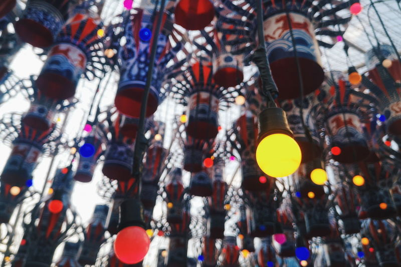 Low angle view of lights hanging on ceiling at market