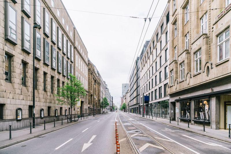 Empty Road Along Built Structures