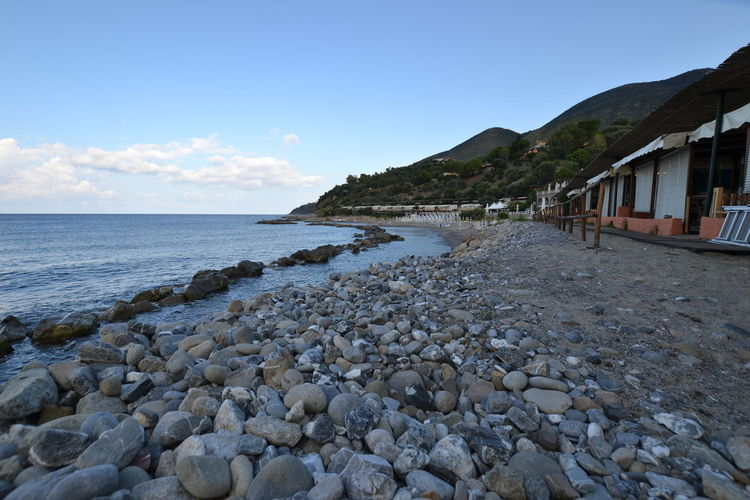 Italy: Cilento landscape Italy Relaxing Sea Beach View From Below Water Summer Pebble Beach Beach Hut Rocky Coastline Rugged Horizon Over Water Seascape