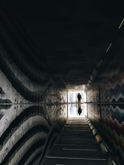The Secret Spaces Tunnel Full Length Real People One Person Walking Rear View Architecture Built Structure The Way Forward Men Leisure Activity Indoors  Illuminated Day One Man Only Adult People Adults Only