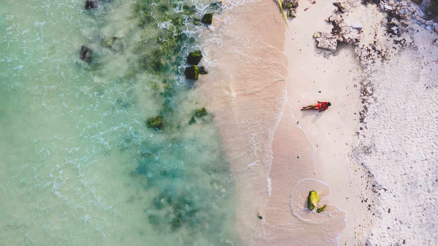 Aerial view of woman lying at beach