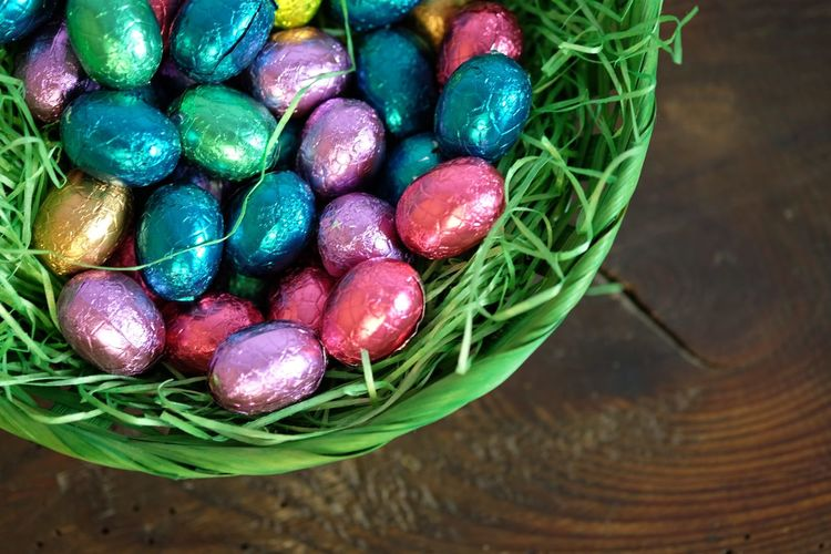 High Angle View Of Colorful Easter Eggs In Basket On Table