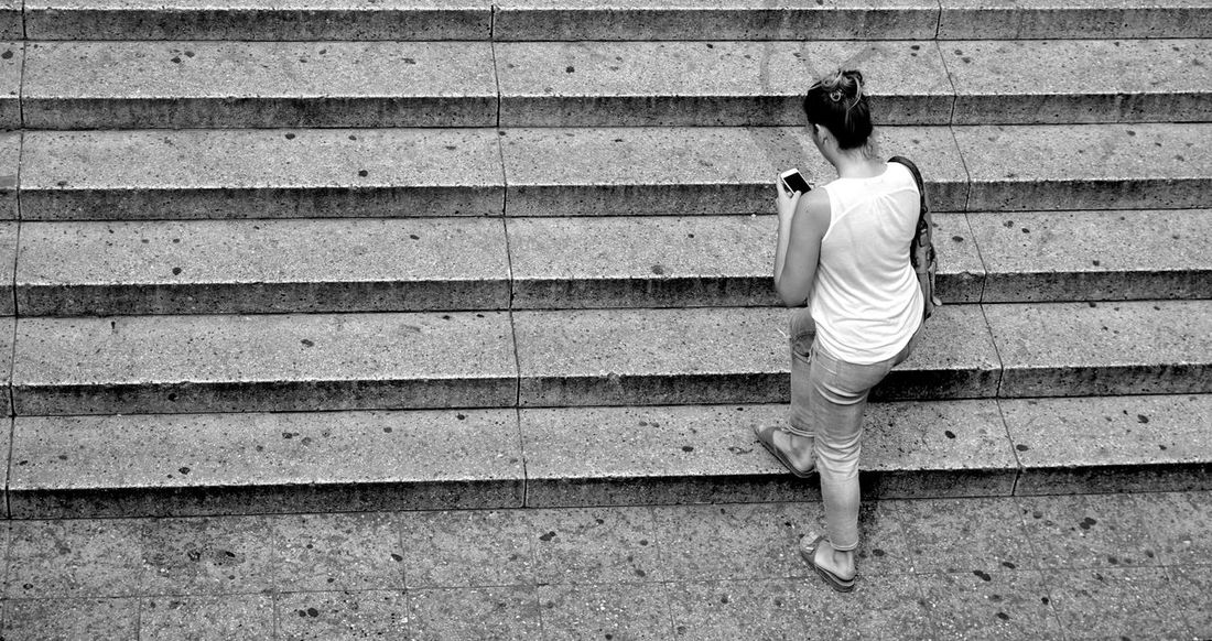 a woman on stairs Alone Ascending Background Black And White Casual Clothing Forwardaltruism Greyscale Outdoors Rising Up Smartphone Stairs Stripes Everywhere Symbol Up Upstairs Walking Woman