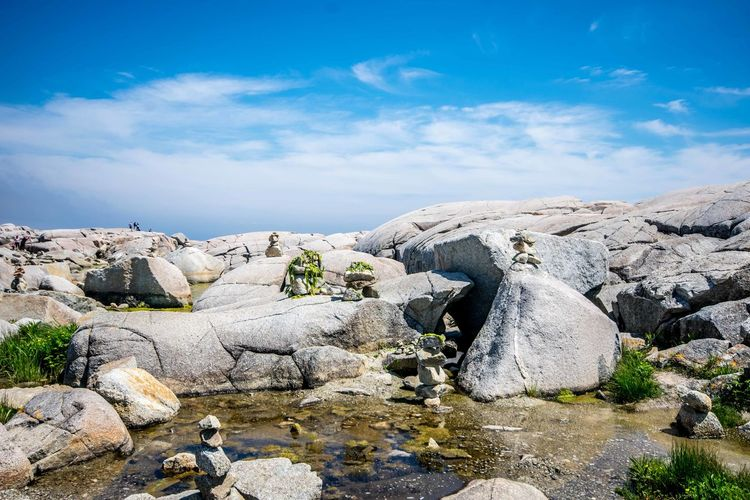 Beautiful day at Peggys Cove, Nova Scotia, Canada. Always a great tourist destination with its stunning views, gift shops, great food & music! Beauty In Nature Cloud - Sky Day Inukshuk Inuksuk Landscape Nature No People Ocean Outdoors Rock Rock - Object Rock Formation Scenics Seaweed Sky Tourism Tourist Tourist Attraction  Tranquility View Water