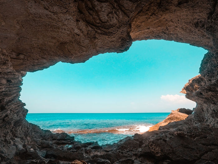 Secret Cave EyeEm Nature Lover EyeEm Gallery EyeEmNewHere Sky Calm Superview Cave Secret Lonely Gopro Water Sea Beach Rock - Object Natural Arch Sky Horizon Over Water Seascape Ocean Rocky Coastline Wave Shore Coast Rock Formation Tide