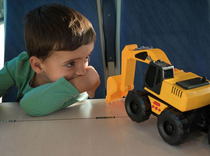 Portrait of boy with toy car