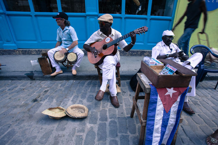 Street musicians playing along the streets of Old Havana, Cuba. Cuba Cuban Drums Flag Guitar Havana Music Musician Paved Road Street Art Streetlife Streetmusician Travel Travel Destinations