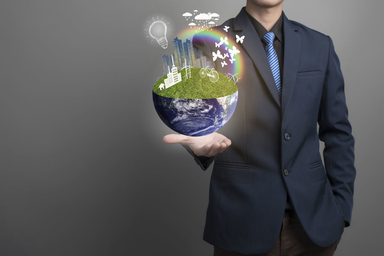 Digital Composite Image Of Businessman And Globe Against Gray Background