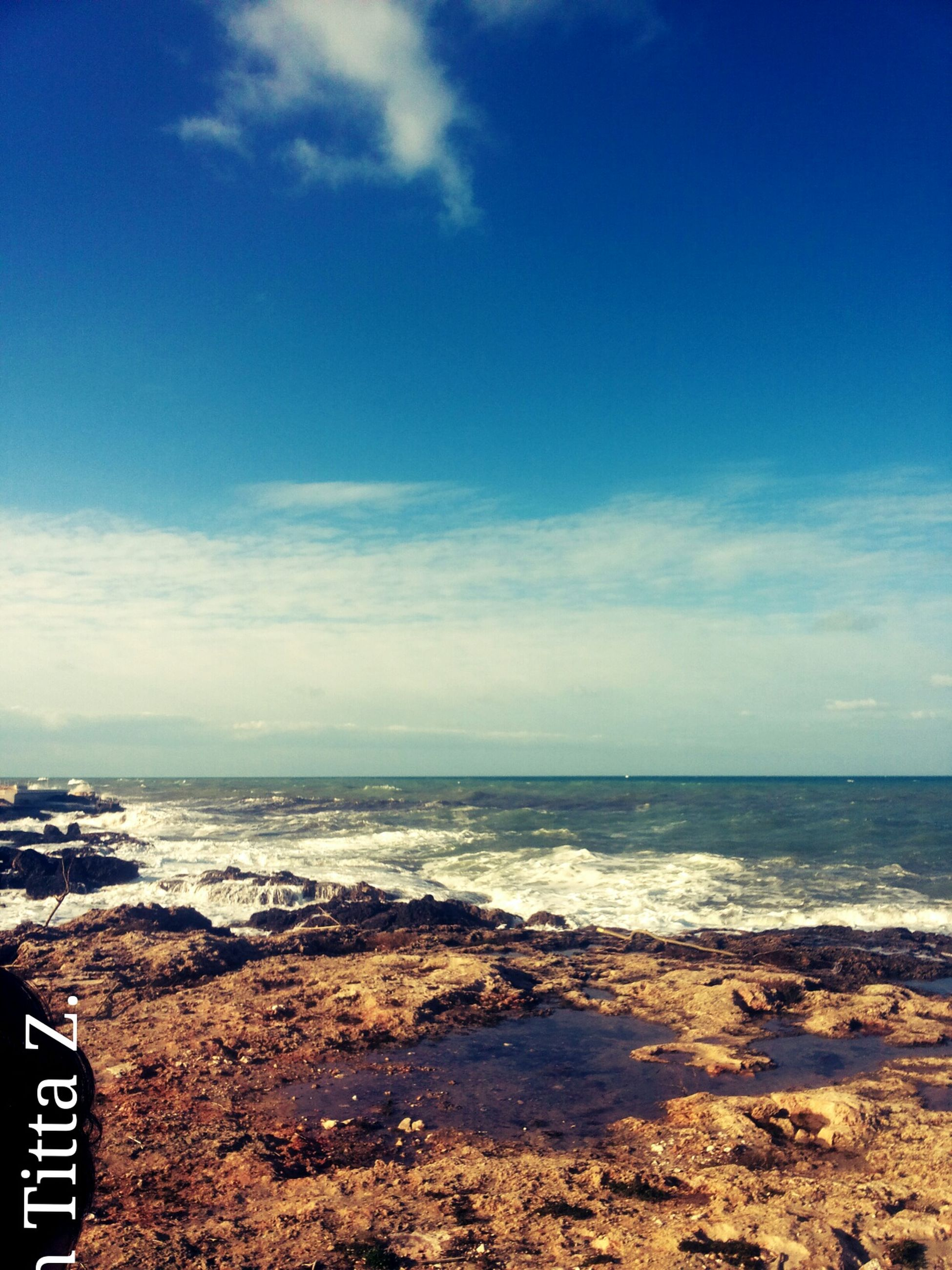 sea, sky, horizon over water, beach, scenics, water, blue, tranquil scene, tranquility, shore, beauty in nature, cloud - sky, nature, cloud, idyllic, day, sand, outdoors, no people, remote