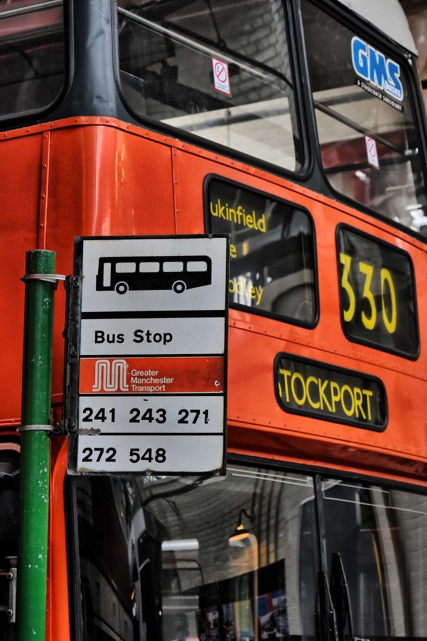CLOSE-UP OF TEXT ON BUS