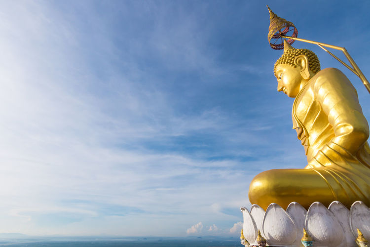 The golden Buddha at the top of mountain, Tiger Cave temple, Krabi, Thailand Clear Sky Budha Budism Gold Top Sculpture Statue Sky Spirituality Religion Cloud - Sky Architecture No People Nature Travel Destinations