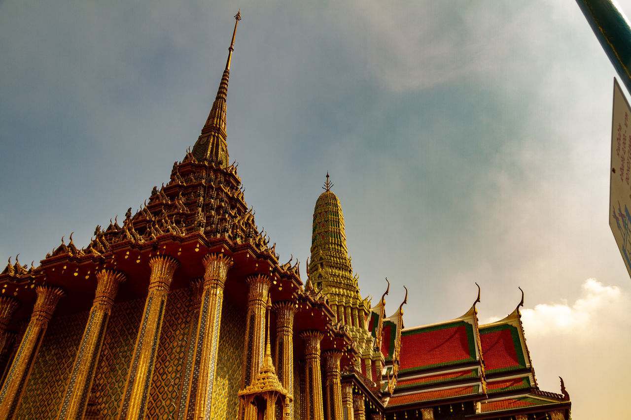 LOW ANGLE VIEW OF TRADITIONAL TEMPLE AGAINST SKY