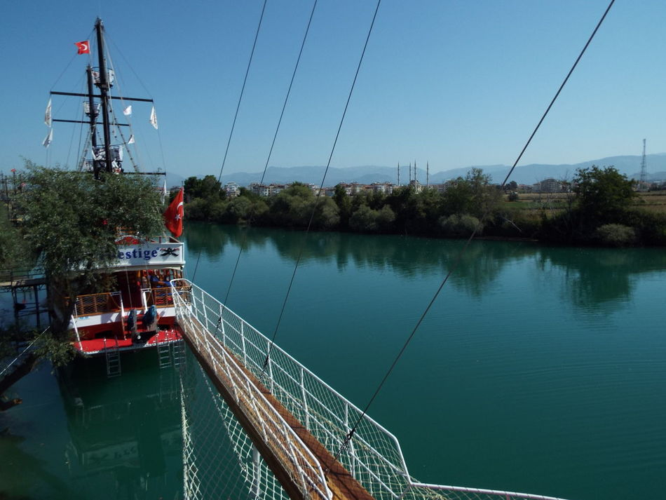 Manavgat River Day Trip Pirate Ship Jolly Roger Boat Blue Sky Blue Mast Flags Rope Ladder Turkish Flag River Water Water Reflections Trees Ropes On The Way