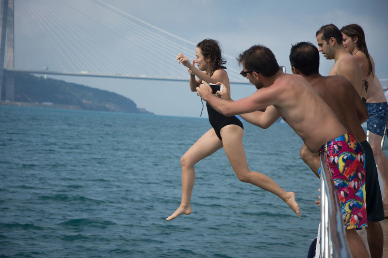 Fun Istanbul Travel Boat Bosphorus Day Holding Jumping Leisure Activity Lifestyles Men Nature Outdoors Real People Scenics Sea Shirtless Sky Standing Togetherness Water Young Adult