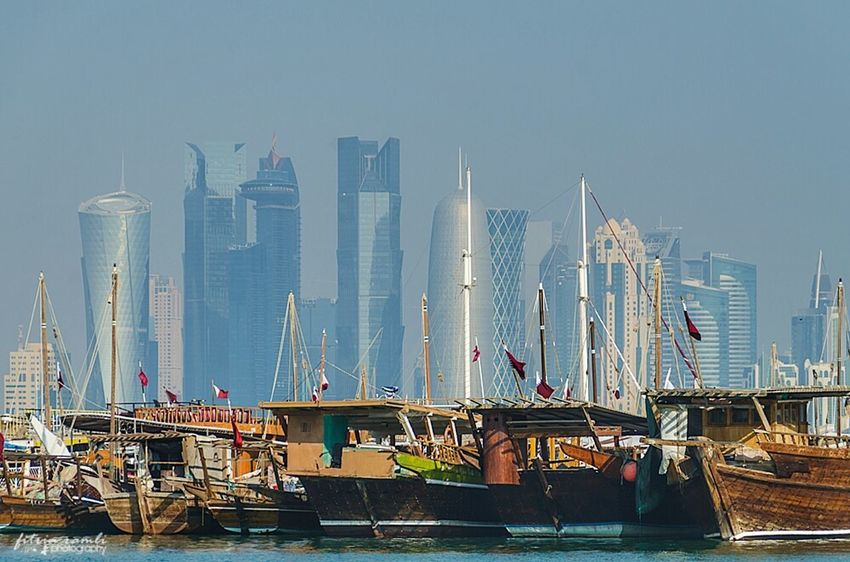 Dhow with Doha City background.. Qatar Doha Cityscapes Landscape Tourism Building Travel Photography Travelling Middle East Arabian Arab Corniche Skyline City Dhow Boat Traditional Modern