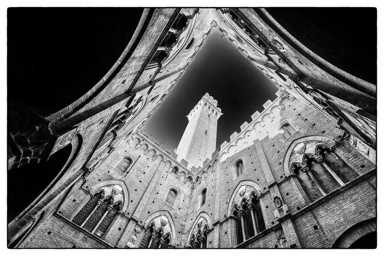 Inside the Palazzo Pubblico in Siena, Italy Travel Italy Siena Blackandwhite Architecture Built Structure Building Exterior Low Angle View Arch History Outdoors Travel Destinations Ancient No People Fish-eye Lens