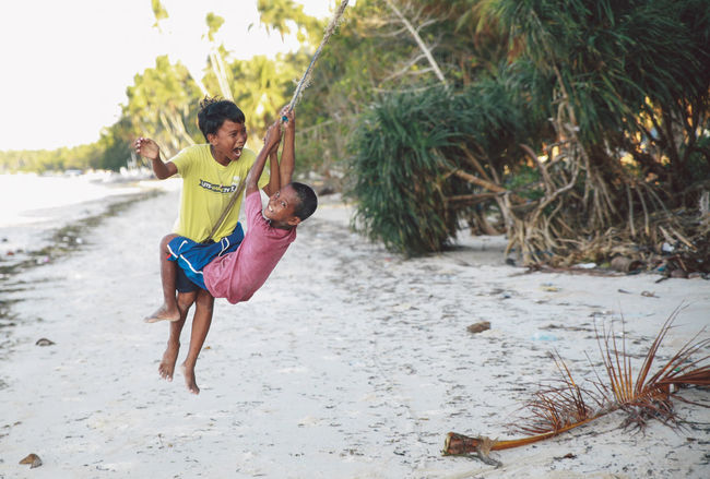Beach Bohol Carefree Childhood Children Snap a Stranger Two Is Better Than One Enjoyment People And Places Fun Natural Light Portrait Laughing Outdoors Panglao Play Playing Rope Sand Sea Seaside Shore Summer Togetherness Tree Water Place Of Heart Connected By Travel Summer Exploratorium Focus On The Story