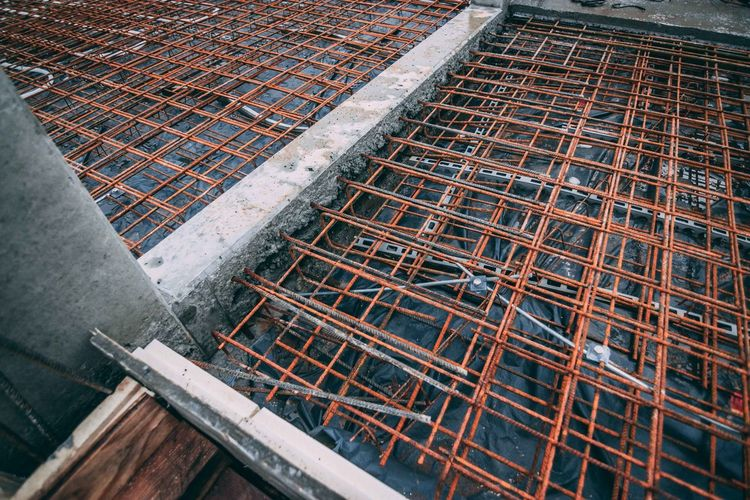 Reinforcement of a bottom plate Building Site Construction Reinforcement Construction Rust Work Building Concrete Construction Site Day Geometry High Angle View Industry Men No People Outdoors Steel