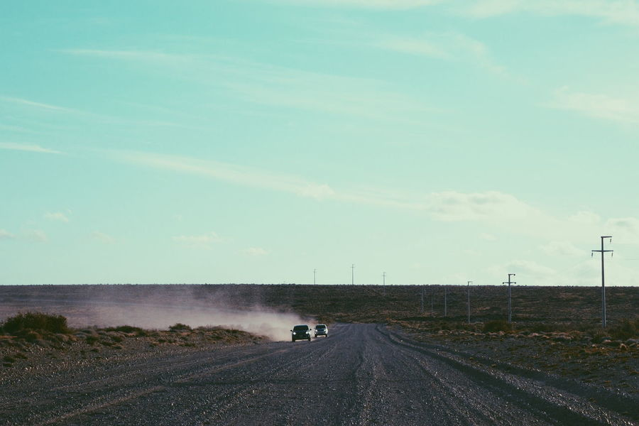 Road Transportation Outdoors Day Water Sky Sea Spraying The Great Outdoors - 2017 EyeEm Awards Scenics South South Of Argentina Patagonia Nature Winding Road Nature Patagonia Argentina No People Dust Dusty Road Dusty Track Desert Pampa Travel Dakar EyeEm Selects Sommergefühle