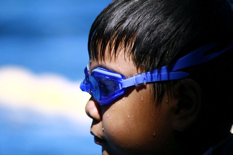 Close-up of boy wearing swimming goggles
