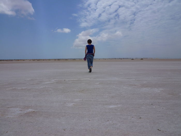 Salty Woman Beauty In Nature Cloud - Sky Day Landscape Nature One Person Outdoors Rear View Remote Salt Basin Salt Flat Scenics Sky Solitude
